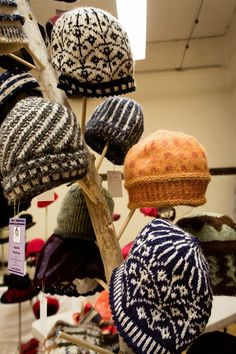 A selection of knit hats by Ingrid Ostheller, as seen at the Millinery Artisan Guild's Showing of Fall & Winter Hats, Sept. 2015.  Photo courtesy of Susan Fry at Heavenly Vision.