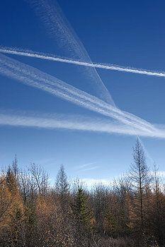 Donald  Erickson - fall landscape with jet vapor trails