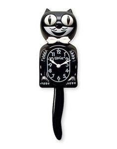 Classic Black Kit-Cat Clock Talk about if it ain't broke don't fix it, this classic black kitty clock has stayed the exact same for the last 80 years except for the small addition of a bow tie sometime in the 50's. Choose from hunter green, candy cane red, scarlet game day, or just plain old black. Each clock comes with a complimentary greeting card.