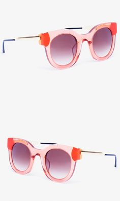 Sunglasses with translucent round frames and a sorbet shade set a retro mood