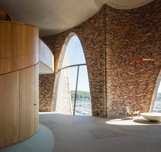 A beautiful office space located by Vejle Fjord in Denmark. It's build with bricks and overlooks the ocean. It is designed by Olafur Eliasson. Vejle, Arch Building, Building Design, Brick Architecture, Contemporary Architecture, Studio Olafur Eliasson, Brick Construction, Curved Walls, Fjord