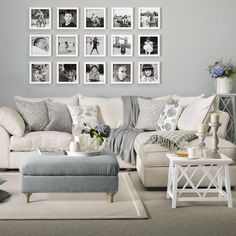 A black and white photo wall looks perfect in this white and grey living room