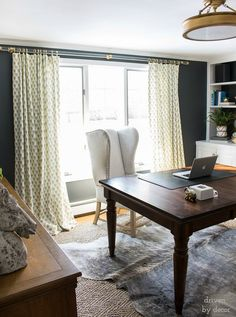Acrylic and brass drapery rods - love how they look against the dark wall! Post includes complete source list!