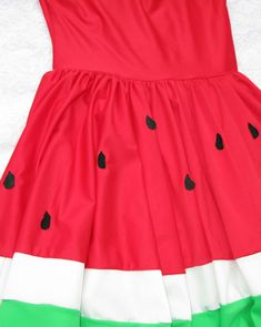 Watermelon dress.  Would also be cute as a skirt.   With black buttons for seeds?