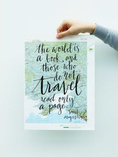 Travel quote screen print on atlas page