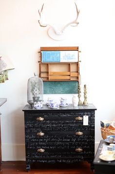 this gives me the best idea for furniture that i'm not in love with but would look great black... this is happening soon