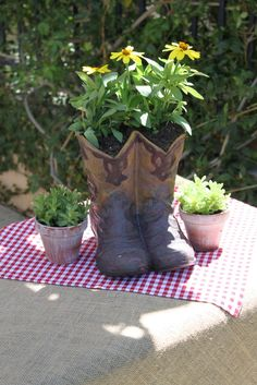 Old cowboy boots as centerpieces #cowboyboots #babyshower