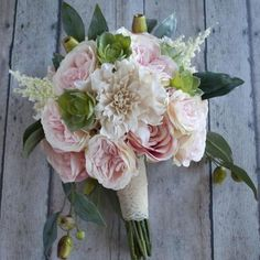 Make your own wedding bouquet with beautiful silk wedding flowersfrom Afloral.com and this simple DIY tutorial from Kate Said Yes Weddings.You will need to gat