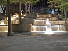 If I ever get engaged again, I hope that this is where he proposes! The Fountain Place building in Downtown Dallas! Landscape Stairs, Landscape Lighting, Landscape Architecture, Landscape Design, Water Lighting, Outdoor Lighting, Diy Garden Fountains, Water Fountains, Water Fountain Design