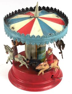 Old German carousel toy. See the man riding the pig? How cute.