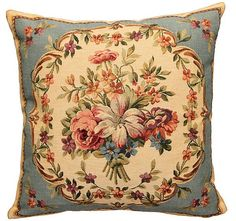 This Museum Collection gobelin cushion cover shows a beautiful flower bouquet in aguirlande frame on beige background  This cushion is woven in Belgium on a jacquard loom with 100% cotton thread. It is lined with a beige velvet backing and closes with a zipper. The gobelin quality