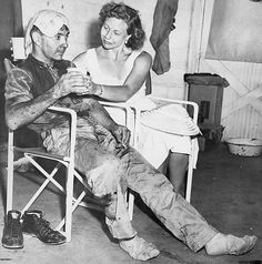 Bill Vukovich and his wife after the  second hottest 500. Indianapolis 1953.
