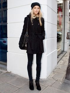 Knit cap and boots to loosen up the all black style.