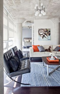 mcm living modern with blue and orange accents