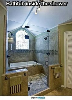 Bathtub inside the double headed shower!