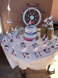 Nautical baptism cake and give a ways.....
