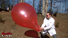 Giant balloon popping in slow motion. So the coolest thing about this gif is that you can really see how the sun is reflected off of TWO surfaces on the balloon — the outside AND THE INSIDE.