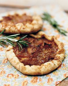 Apple-Onion Tarts  Caramelized apples and onions are a mouthwatering combination, especially when wrapped in a rosemary and manchego cheese crust. S