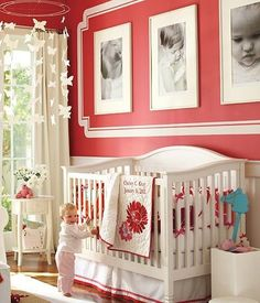 the colors aren't my first choice, but I love the white trim on the wall with the white frames...this idea is a keeper!
