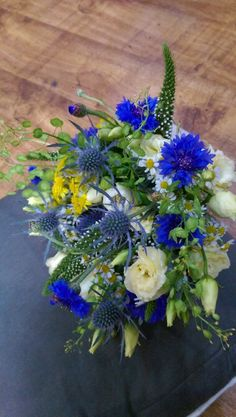 Blue corn flowers, blue thistle, cream lisianthus and daisy wild flower bridal bouquet. www.enchantedflorals.co.uk