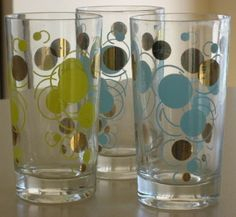 Three vintage eclipse drinking glasses in yellow and blue with gold.