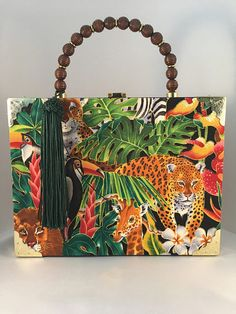 Exotic Jungle Cigar Box Purse * Covered with Jungle print Fabric * Brushed Gold Clasp * Handmade brown beaded handle * 5 Long Green Tassel * L, 7 H, W. Cigar Box Crafts, Cigar Box Purse, Jungle Print, Printing On Fabric, Exotic, Projects To Try, Purses, Unique Jewelry, Handmade Gifts