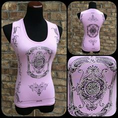 B2G1-FREE NWOT Lavender Tribal Studded Tank Top New without tags reposh but didn't fit. Very pretty and sexy lavender/ pink tank top. Top features gorgeous tribal design with silver studs and rhinestones on the front. The back is beautiful as well. This is a size small with a little stretch and rubs small like XS. ALL CLOTHES & SELECT JEWELRY BUY 2 GET ONE FREE!! Boutique Tops Tank Tops