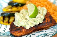 Grilled salmon with greek yogurt guacamole, spanish rice, and grilled zucchini 650 kcal. Portion sizes can be found on http://www.fitlessflavor.com/week-10/