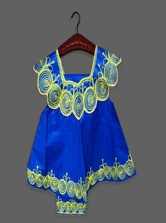 Traditional Girl Suit (CHGL8)    Blue traditional African girl's suit with embroidery. Made from dyed cotton, this dress provides comfortable apparel for girls during summer.