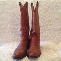 Justin Ostrich Cowboy Boots Vintage Justin Cllassic Cowboys Boots. Ostrich brown leather. Style #D7189. The heels and possibly the sole have been replaced, the heels replaced with Cat's Paw pads. These boots do show signs of wear, to include scuffing and creasing on the toe are. Great vintage condition. Smoke free home. Justin Shoes Heeled Boots