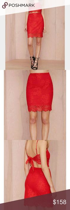 For Love & Lemons Tiki Bar Lace Skirt For Love & Lemons always does lace right, so get ready to fall in love with the Tiki Bar Skirt. It has a cherry lace shell, partial lining, and zip/hook closures at side. Wear it with the Tiki Bar Crop Top and minimal heels, or a tissue-thin tee and oxfords. In this case, lace is more.  *Polyester/Nylon/Spandex? *Runs true to size? *Model is wearing smallest size available? *Dry Clean? *Imported For Love and Lemons Skirts