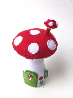 My litttle effort for the UK Etsy Challenge.  I want to move in!  Made from felt, and embroidered by hand, stuffed with polyester stuffing.  Front view, of the teensy door, with mini mushroom door knocker!   etsy