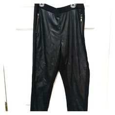 Dividend Black Faux Leather Skinny Pants. H&M Black faux leather front. Cotton back. Two metal zippers in the front. Size L. With original tag. H&M Pants Skinny