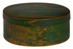 "Willis Henry Shaker Auction 10/12/15 Lot 36:  Estimate: $800 – $1,000. Realized: $1,320. Description:  Oval Box, Pine and maple, original green painted finish, four fingers facing right to left, secured with symmetrically nailed copper tacks, c. 1820-1830, Sabbathday Lake or Alfred, ME, normal in-use wear, small identification tag under lid ""115"", 4″ h, 10″ w, 7 3/8″ d, (ex. Don Emerich collection)."