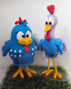 A Galinha Pintadinha e o Galo Carijó a galinha usa saia e o galo paletó