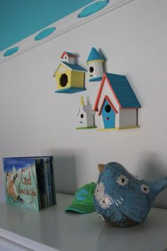 Love the bird houses hung on the wall
