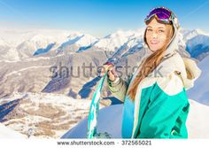 Snowboard. Female snowboarder on the background of high snow-capped Alps in Swiss