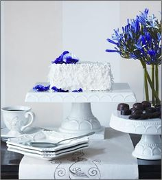 Simple white with stand out accent florals #HomeGoodsWedding - Repin to win!