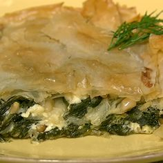 Michael Symon's Phyllo Pie from Greece    Ingredients  4 pound Spinach (trimmed/washed)3 cloves Garlic (sliced)3 tablespoons Extra Virgin Olive OilSalt and Pepper1/4 cup Pine Nuts1 cup Dill (leaves only)Zest of 1 Lemon3 cups Feta (crumbled)1 box Phyllo Dough (thawed)1/2 cup Butter (melted)    http://beta.abc.go.com/shows/the-chew/recipes/Phyllo-Pie-Michael-Symon?cid=facebook_chewmichaelphyllopie