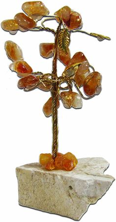 This beautiful gemstone tree is made of yellow Carnelian and measures at 19 cm (10 inches) high