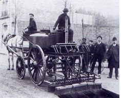 This is a photo of the very first paving crew applying a Tar & Chip road .pulled by horse and carriage