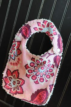 The Little Fabric Blog: Easy Baby Bib Tutorial. Great tip in the comments