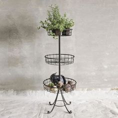 For an intriguing decorative touch, fill the three wire basket levels of this table with candles and your favorite greenery. In black iron and wire, it's a fanciful alternative to ordinary end tables.  Find the Stacked Baskets Side Table, as seen in the Our Favorite Farmhouse Designs Collection at http://dotandbo.com/collections/our-favorite-farmhouse-designs?utm_source=pinterest&utm_medium=organic&db_sku=CCO0327