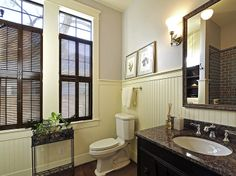 Beautiful stained traditional shutters in a bathroom. Traditional Shutters, Indoor Shutters, Painting Shutters, Interior Shutters, Custom Wood, Porcelain, Living Room, Mirror, Bathroom