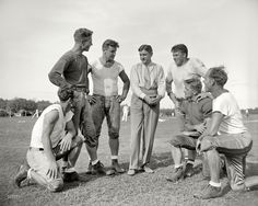 Sept. 11, 1937. Washington, D.C. George Marshall, owner of the Washington Redskins, talks it over with some of his players, left to right: Wayne Millner, tackle, end; Charlie Malone, end; Vic Carroll, tackle; George Marshall and Bill Young, tackle; Ed Michaels, guard; Jim Garber, tackle.