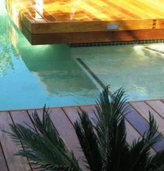 Corner detail of timber decking next to pool