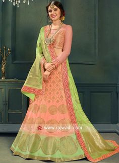 Shop Online Peach and Green Woven Lehenga Choli. Celebrate a blend of tradition and style with this jacquard silk lehenga decorated with all over zari woven motifs. This lovely lehenga is teamed up with a matching net choli and green jacquard silk woven d Lehenga Anarkali, Lehenga Choli Online, Silk Lehenga, Dresses Online Usa, Indian Dresses Online, Indian Wedding Lehenga, Indian Lehenga, Western Lehenga, Half Saree Designs