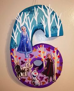 Frozen pinata Tall 27 Wide 17 Deep 5 Can hold 3 to 4 pounds of candy Candies not include The pinata is made by order If you want another number, write in the note the number. Birthday Pinata, Frozen Themed Birthday Party, Disney Frozen Birthday, Frozen Birthday Party, 2nd Birthday Parties, Birthday Collage, Frozen Pinata, Frozen Balloons, Frozen Birthday Decorations