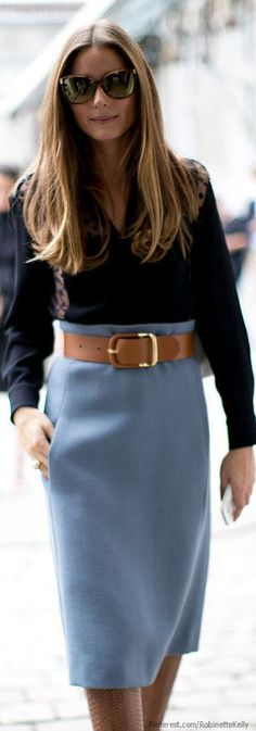 High waist blue skirt, huge brown belt and black blouse on Olivia Palermo