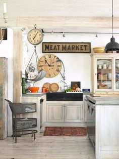 Go Country for Less  This homeowner cut costs by whitewashing the beams, floors, and kitchen cabinets themselves. The Meat Market sign came from a restaurant where they once worked.    Read more: Antique Milk Glass Pendant Lamps Kitchen - Kitchen Designs - Country Living
